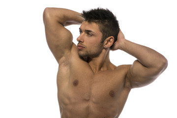 Attractive young muscle man showing athletic torso and biceps