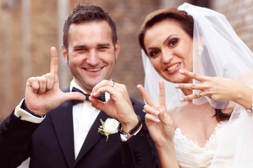 Bride and groom writing LOVE with their fingers