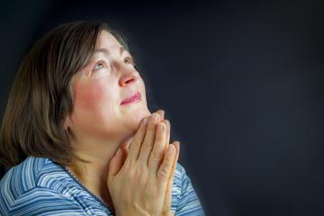 Adult woman praying