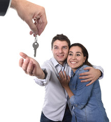 young couple receiving new house key real state concept