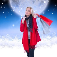 Blonde in winter clothes holding shopping bags