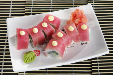Sushi menu rolls out the red fish on a plate