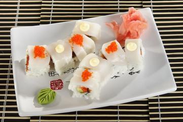 Sushi menu: a set of rolls scallops on a plate.