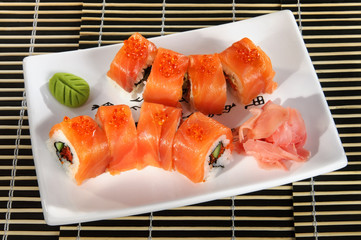 Sushi menu: a set of rolls of red fish on a plate.