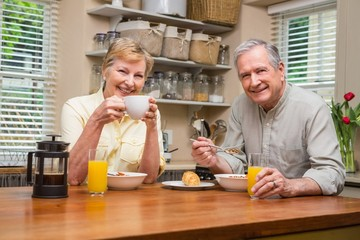 Senior couple having breakfast together