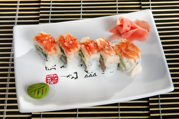 Sushi menu rolls scallop and flying fish caviar on a plate.