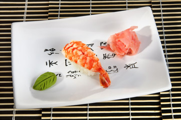 Sushi menu: shrimp with wasabi and ginger on a plate.