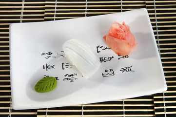Sushi menu: octopus with slices of cucumber, seaweed on a plate.