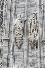 Grungy monuments at facade of the Duomo Cathedral