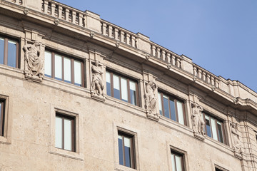 Antique facade with sculptures and blue sky