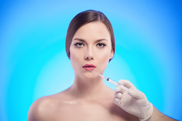woman getting cosmetic injection of botox