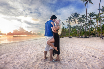 man and woman - dawn at the beach