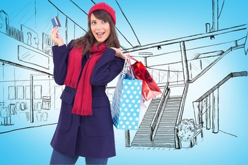 Brunette holding shopping bags and credit card