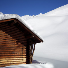wooden house in the snow