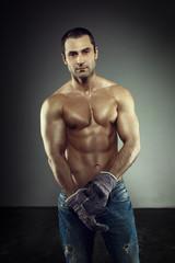 Sexy macho worker posing