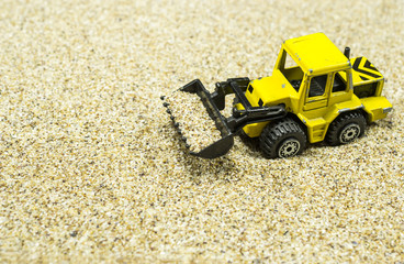 Front loader toy on sand
