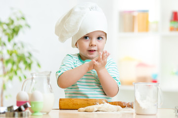 little baker child girl in chef hat