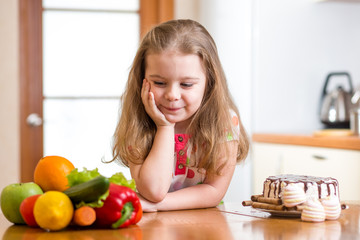 child choosing between healthy vegetables and tasty sweets