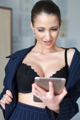 Sexy naked businesswoman chat by tablet