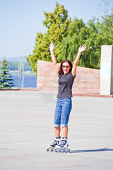 Woman on roller skates in sunglasses