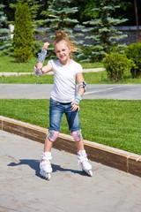Learning girl on roller skates