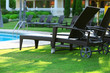 Lounge sunbeds near swimming pool