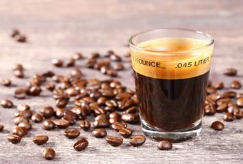 Espresso shot glass with coffee bean