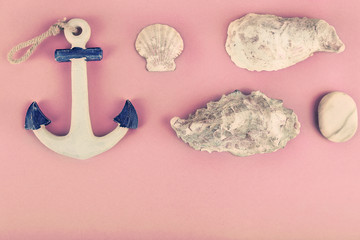 Sea souvenirs on pink background
