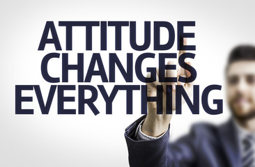 Business man pointing text: Attitude Changes Everything
