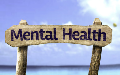 Mental Health sign with a beach on background