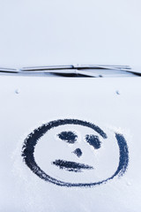 Smiley on the hood of the car. First snow