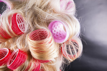 Woman with curlers in her blonde hair (background, wallpaper)