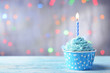 Delicious birthday cupcake on table on light background - 73787666