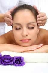 Portrait of beautiful woman taking head massage