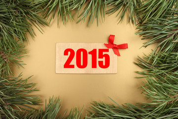 New Year background. Christmas tree and wooden plate with 2015