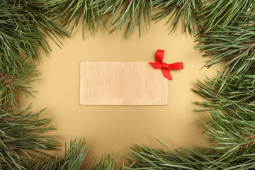 Gold Christmas background. Christmas fir tree and wooden plate