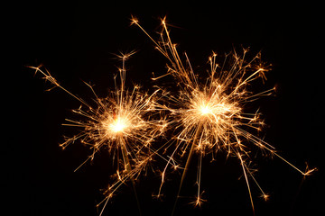 Two burning christmas sparklers