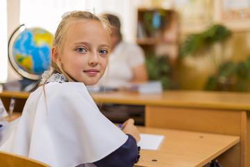 pupil at a school desk