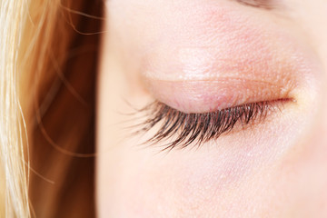 Closed female eye close-up