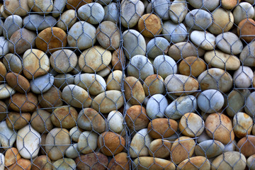 Pebbles stored behind a grid