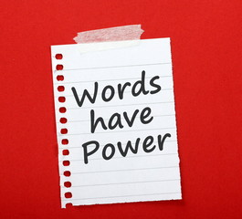 The phrase Words Have Power on a note taped to notice board