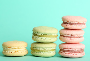 Gentle colorful macaroons on color background