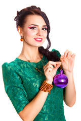 Beautiful young woman with a purple Christmas bauble
