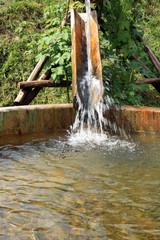 Wooden, flowing water tanks. Decoration garden irrigation.
