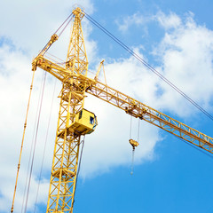 crane on blue sky background