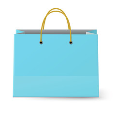 View of classic blue paper shopping bag with yellow rope grips