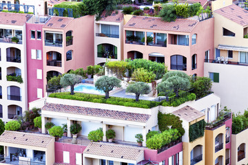 Colorful apartments with roof gardens, balconies and patios