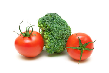 Two ripe tomatoes and broccoli isolated on white background