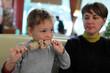 Kid eating kebab
