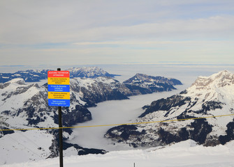 Stand with warning of ski slope. Titlis, Engelberg, Switzerland